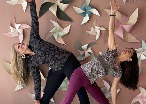 women in triangle pose