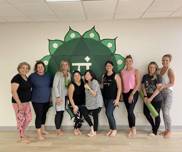 ladies standing in the yoga studio